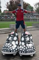 Soccer player in very large shoes