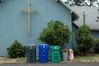 church with garbage and recycle binds