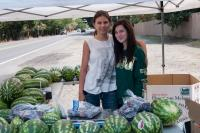 two girls selling watermelons