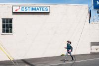 person walking and sign that reads Estimates
