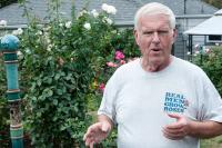 man with shirt that says real men grow roses