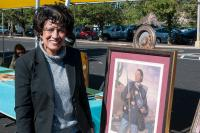 portrait of a woman with a painting of woman buffalo soldier