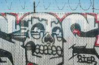 graffiti painted on a fence