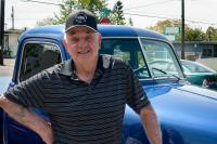 portrait of man with old blue truck