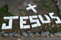 a cross and Jesus made with white bricks