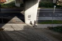 woman walking past graffiti
