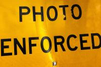 close up of Photo Enforced sign