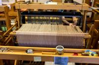 person working on a loom
