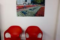 red chairs with photo