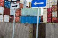 stack of containers with two signs pointing