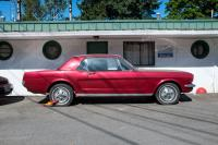 red Mustang with boot at motel