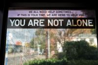 sign in a bus shelter