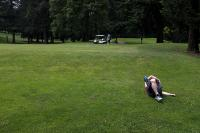 person strectching on a golf course
