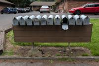 row of mailboxes with one open