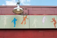 sign with silhouettes of people dancing
