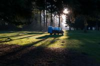 truck carrying a porta potty on golf course
