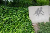 concrete sign with silhouette of two children
