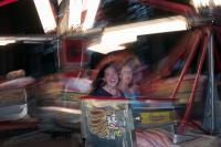 two girls on a amusement ride at Oaks Park