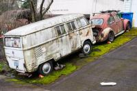 old vw bug and bus sitting in a sloped driveway