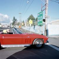Red Chevrolet Corvette SE Washington and 92nd Ave
