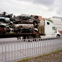 Truck carrying crushed cars on N Lombard